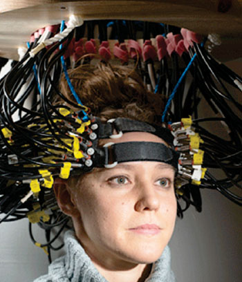Image: Research participant Britt Gott wears a cap used to image the brain via diffuse optical tomography (DOT) (Photo courtesy of Washington University School of Medicine in St. Louis).